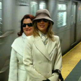 professional woman in subway station traveling in white with hat testimonial