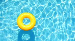 yellow lifeguard donut doughnut livesaver birds eye view clear swimming pool